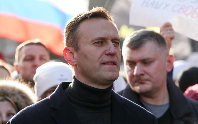 Pemimpin oposisi Rusia Alexei Navalny berjalan bersama para demonstran lainnya dalam unjuk rasa di Moskow, Rusia, Sabtu (19/2/2019). - Bloomberg/Andrey Rudakov