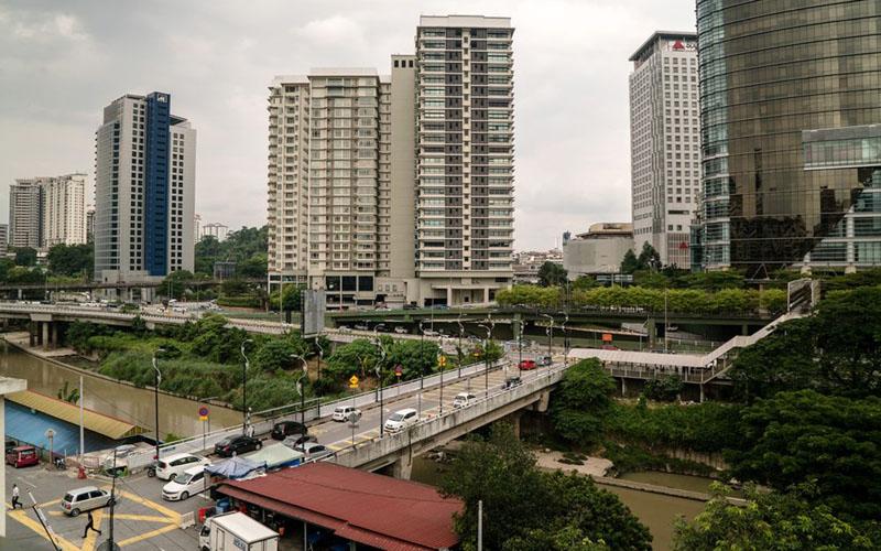 Bangunan apartemen di dekat Sungai Klang di Kuala Lumpur, Malaysia./Bloomberg - Sanjit Das