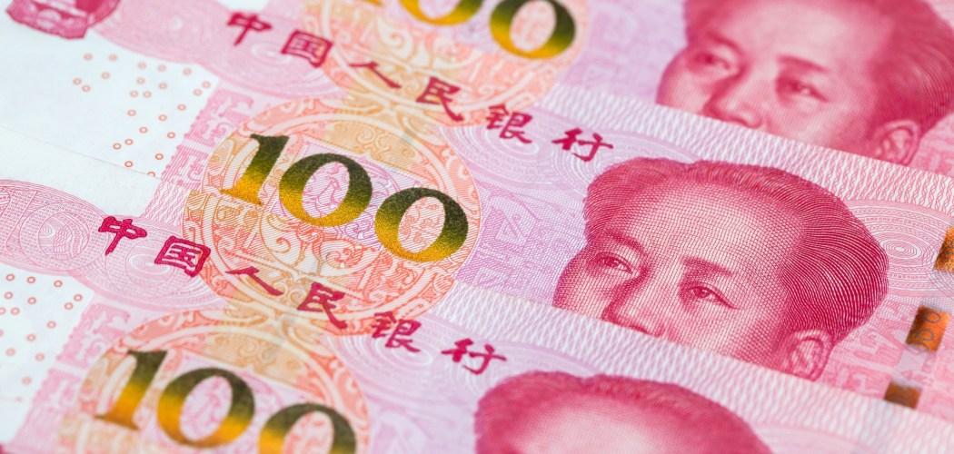 Lembaran uang yuan. - Bloomberg/Paul Yeung