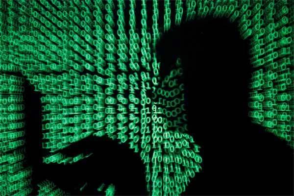 Ilustrasi kejahatan siber. RUU PDP telah mengecualikan kegiatan monetisasi dari lingkup jual atau beli data pribadi.  - Reuters/Kacper Pempel