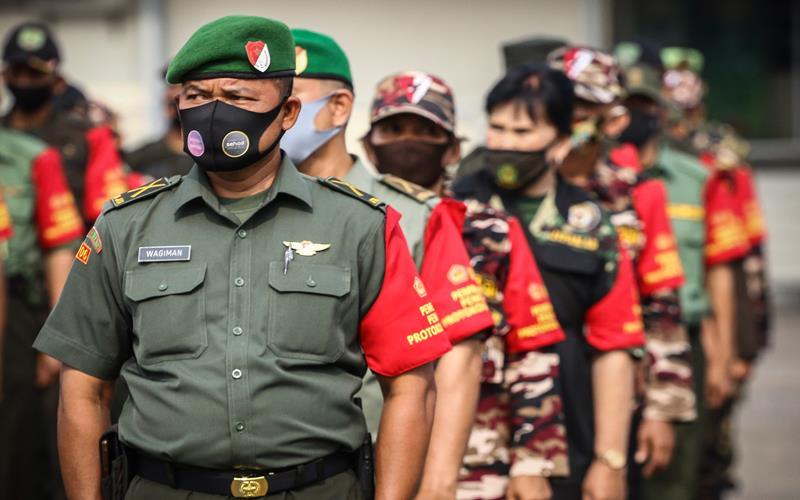 Ilustrasi-Personel gabungan TNI, Polri dan Organisasi Masyarakat saat mengikuti apel Gelar Pasukan Pembantu Penegakan Protokol Kesehatan Covid-19 Berbasis Komunitas (Ormas) di JIExpo Kemayoran, Jakarta, Senin (14/9/2020). - Antara/Rivan Awal Lingga