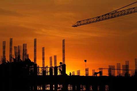 Pembangunan konstruksi proyek gedung di Jakarta. - Bisnis