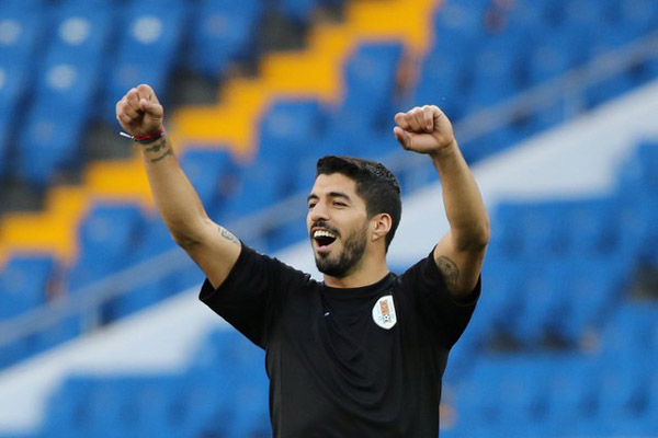 Striker Luis Suarez  -  Reuters