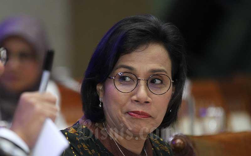 Menteri Keuangan Sri Mulyani Indrawati saat mengikuti rapat kerja antara Komisi XI DPR RI dengan pemerintah di kompleks parlemen, Jakarta, Senin (2/12/2019). Bisnis - Arief Hermawan P