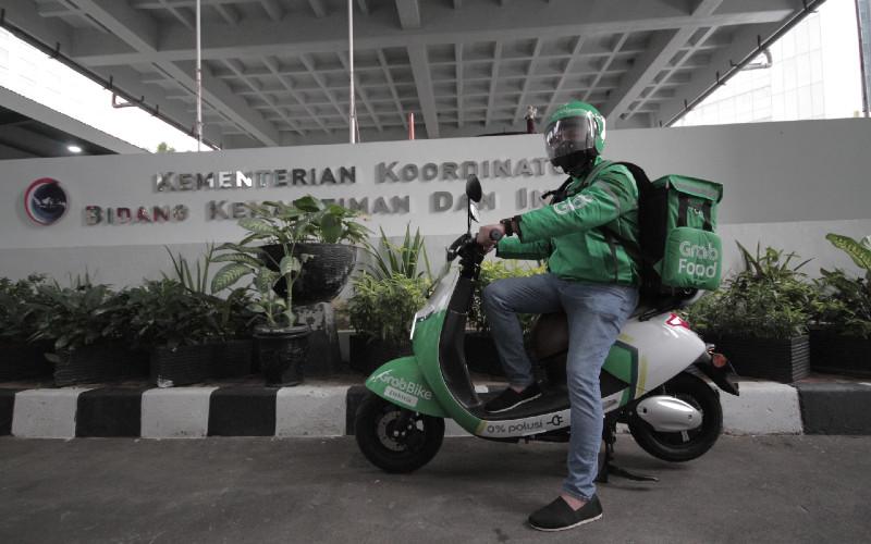 Ilustrasi layanan Grab Indonesia - GrabBike Electric. Pada tahap awal Grab meluncurkan armada 50 sepeda motor listrik di DKI Jakarta.  - Grab