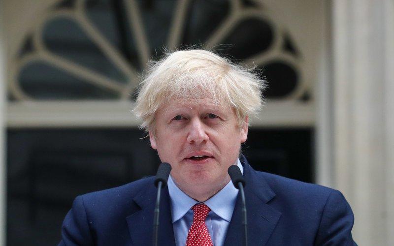 Perdana Menteri Inggris Boris Johnson memberikan pidato resmi pertamanya setelah sembuh dari Covid-19 -  Bloomberg / Simon Dawson