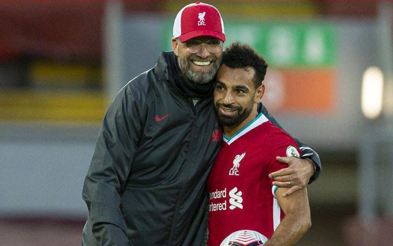 Pelatih Liverpool Jurgen Klopp dan ujung tombak Mohamed Salah. - LiverpoolFC.com