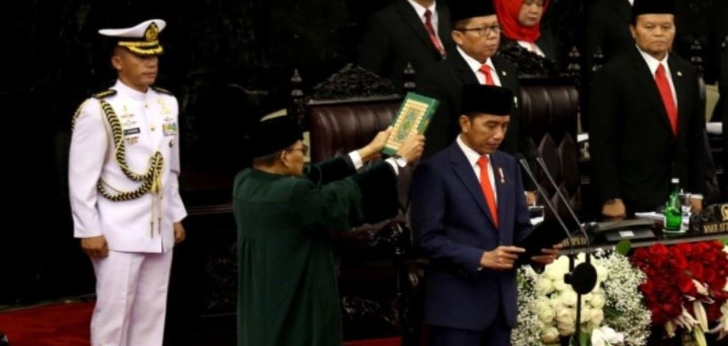 Presiden Joko Widodo saat dilantik menjadi presiden periode 2019-2024 di Gedung Nusantara, kompleks Parlemen, Senayan, Jakarta, Minggu (20/10/2019) - Bisnis - Nurul Hidayat