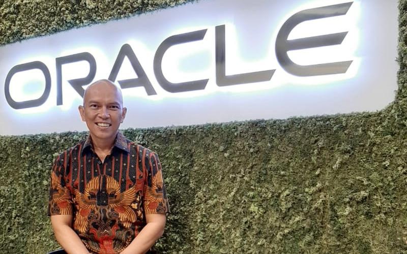 Iman Muhammad, Head of Applications Oracle Indonesia. Keadaan krisis saat ini telah membuktikan perusahaan dapat menjalankan sistem kerja jarak jauh.  - BISNIS
