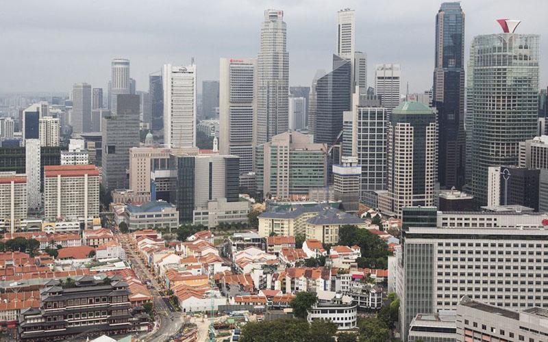 Perumahan dan properti komersial di Singapura./Bloomberg - Ore Huiying