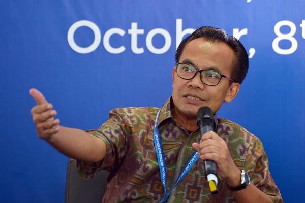 Sekretaris Menteri Kemenko Perekonomian Susiwijono Moegiarso menyampaikan berbagai perkembangan yang terjadi pada Pertemuan Tahunan IMF - World Bank Group 2018 dalam konferensi pers di Nusa Dua, Bali, Selasa (9/10/2018). - Antara/Nyoman Budhiana
