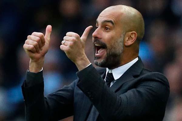 Pelatih Manchester City Pep Guardiola. - Reuters