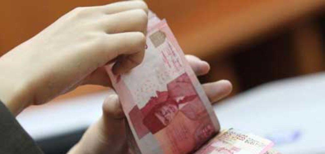 Ilustrasi seseorang yang sedang menghitung uang.  - istimewa