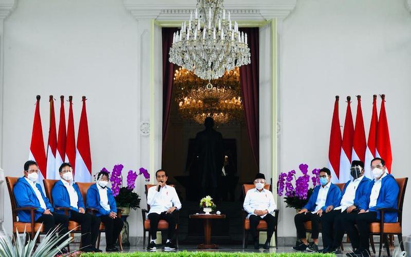 Presiden Joko Widodo (Jokowi) mengumumkan rencana reshuffle kabinet Indonesia Maju didampingi oleh Wakil Presiden Maruf Amin dan enam calon menteri.  - Biro Pers Sekretariat Presiden/Laily Rachev