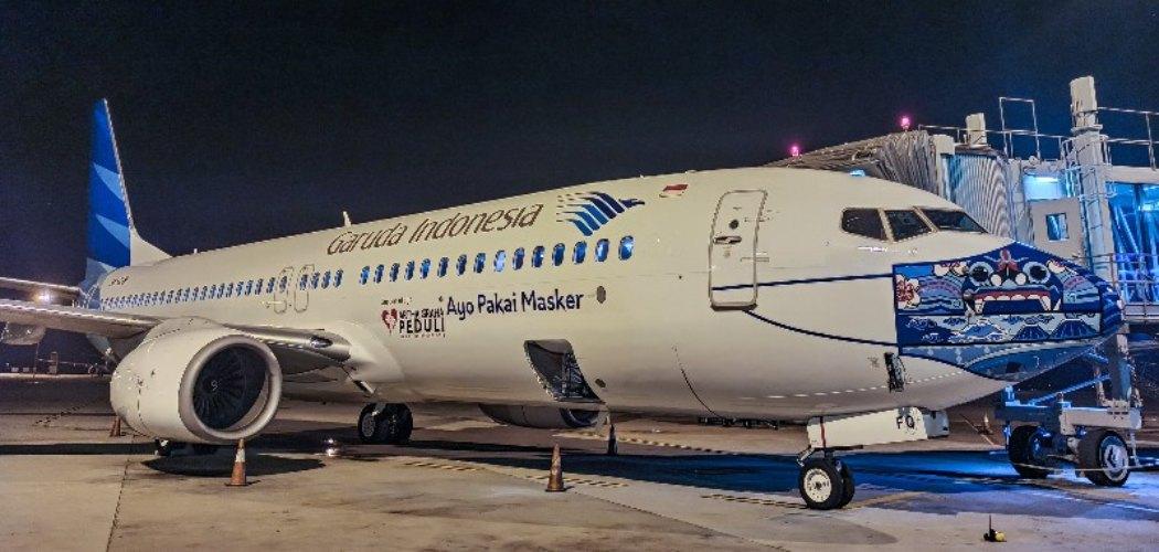 Pesawat Garuda bermasker.  - Istimewa