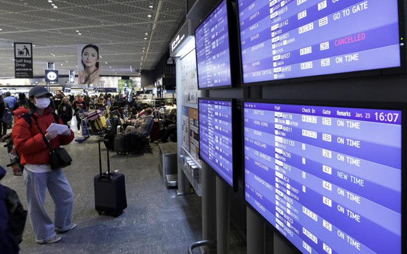 Ilustrasi - Ruang tunggu penumpang di Bandara Internasional Narita di Tokyo, Jepang, sebelum terjadi pandemi Covid-19. - Bloomberg