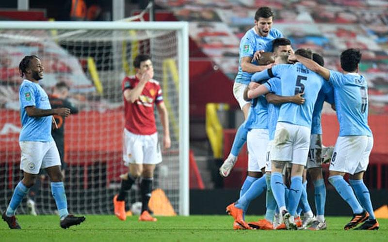 Para pemain Manchester City merayakan gol kedua ke gawang Manchester United. - The Guardian