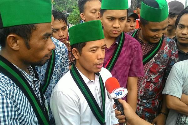 Ketua Umum Pengurus Besar Himpunan Mahasiswa Islam (Ketum PB HMI) Mulyadi P Tamsir memenuhi panggilan penyidik Polda Metro Jaya guna menjalani pemeriksaan lanjutan terkait kerusuhan unjukrasa 4 Nombember 2016. - Bisnis