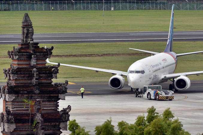 Pesawat Sriwijaya Air, berada di kawasan Bandara Internasional I Gusti Ngurah Rai, Bali, Jumat (8/3/2019). - ANTARA/Fikri Yusuf