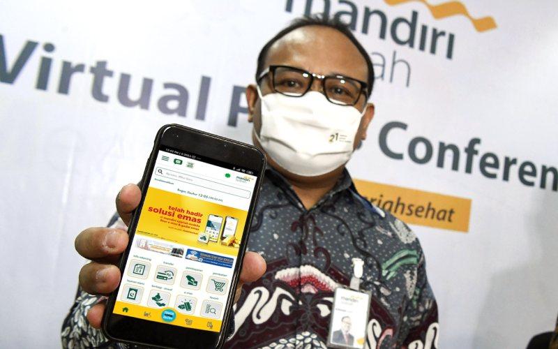 Riko Wardhana, Group Head of Digital Banking Sales & Partnership Group PT. Bank Syariah Mandiri menjelaskan fitur layanan e-Mas yakni pembelian e-Mas dan Gadai Emas.  - Dok. Bank Mandiri Syariah