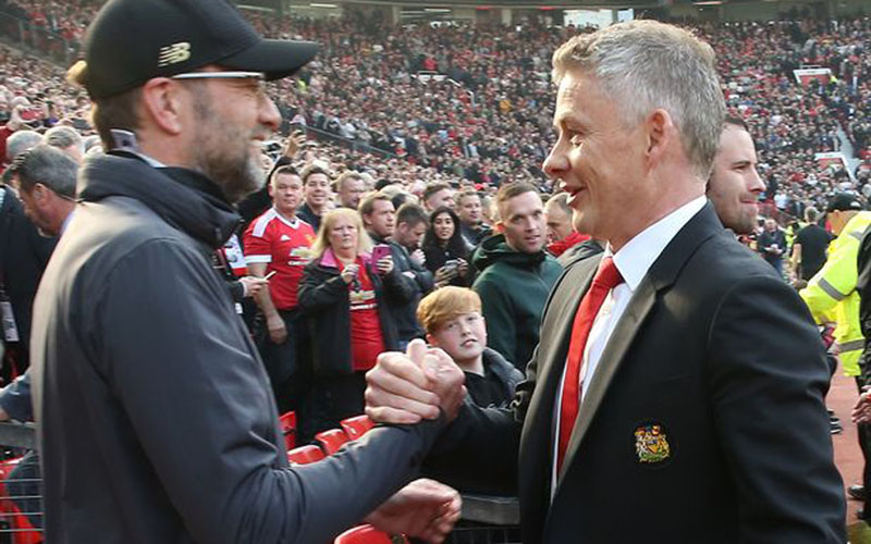 Pelatih Liverpool Jurgen Klopp (kiri) dan pelatih Manchester United Ole Gunnar Solskjaer. - ManUtd.com