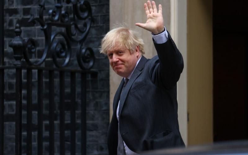 Perdana Menteri Inggris Boris Johnson kembali dari Parlemen di London, Inggris, pada Rabu (30/12/2020). - Bloomberg
