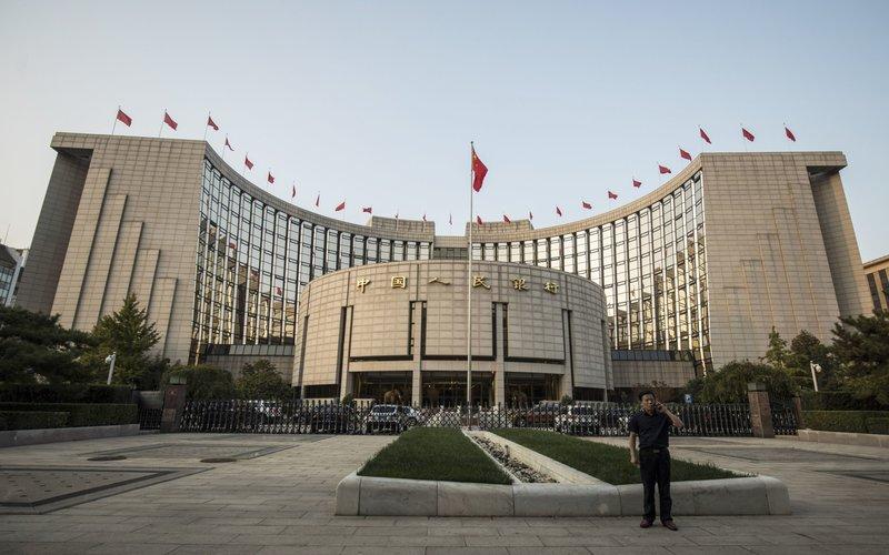 Kantor pusat People's Bank of China di Beijing -  Bloomber / Qilai Shen