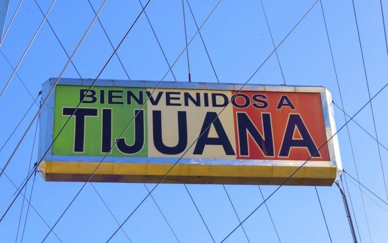 Ilustrasi - Sebuah papan ucapan selamat datang di kota Tijuana, kota terbesar di negara bagian Baja California, Meksiko. Sebanyak 2.337 dari 4.760 pasien Covid-19 yang dirawat di rumah sakit negara bagian tersebut dinyatakan meninggal. - Bloomberg