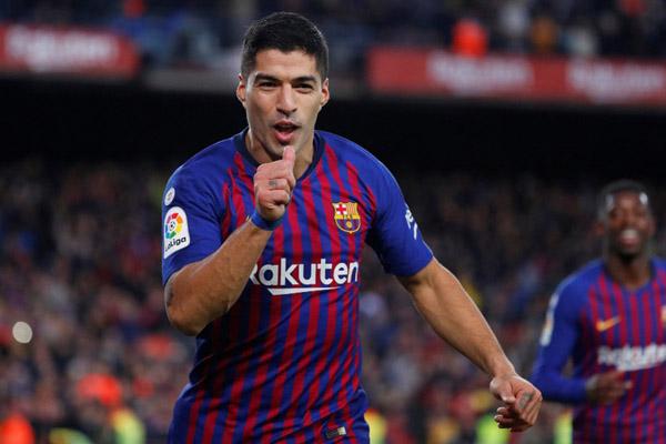 Luis Suarez ketika masih berseragam Barcelona. - Reuters