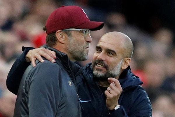 Pelatih Liverpool Jurgen Klopp (kiri) dan pelatih Manchester City Pep Guardiola - Reuters