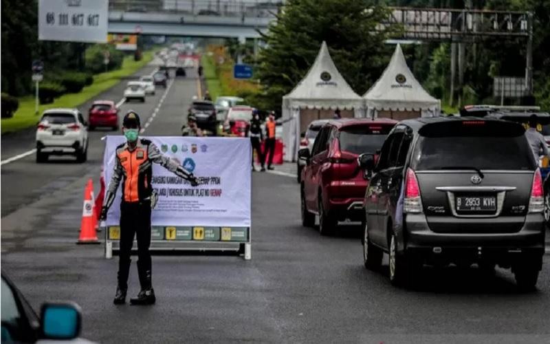 Pelaksanaan kebijakan ganjil-genap bai kendaraan bermotor di Kota Bogor, pada akhir pekan. - Antara\r\n\r\n\r\n
