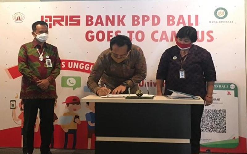 Penandatanganan kerja sama sistem pembayaran QRIS antara BPD Bali dengan Undiknas Bali, Selasa (25/8/2020). - Bisnis/Ni Putu Sri Widyastini Susila