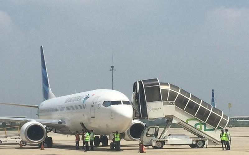 Penerbangan kargo memakai pesawat Garuda Indonesia dari Bandara Kertajati Majalengka menuju Bandara Internasional Hang Nadim, Batam, Selasa (23/2/2021).  - Bisnis/Wisnu Wage
