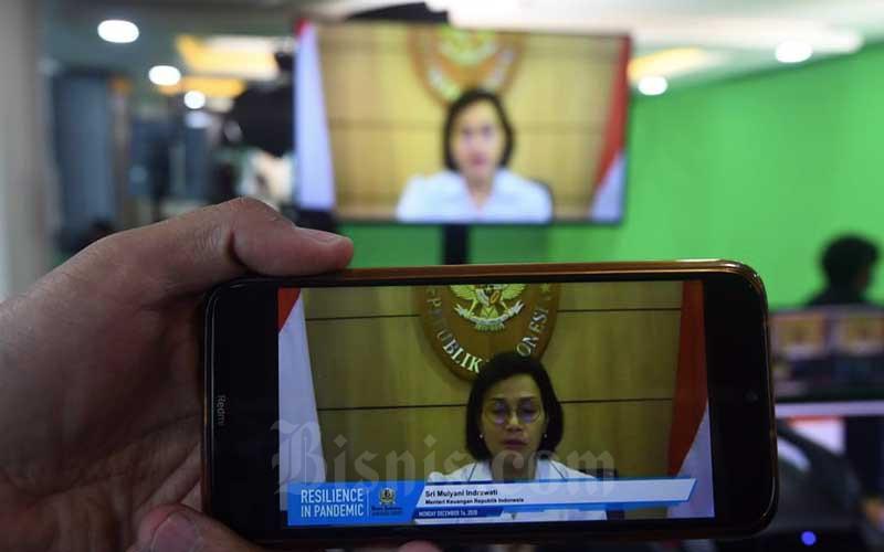 Menteri Keuangan Sri Mulyani memberikan sambutan s3cara virtual saat acara Bisnis Indonesia Award di Jakarta, Senin (14/12/2020). Bisnis - Abdurachman