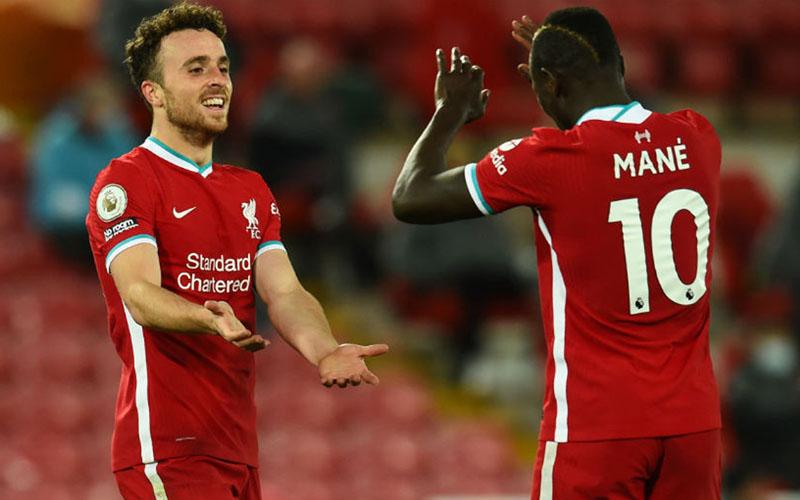Dua andalan Liverpool, Diogo Jota (kiri) dan Sadio Mane. - LiverpoolFC.com