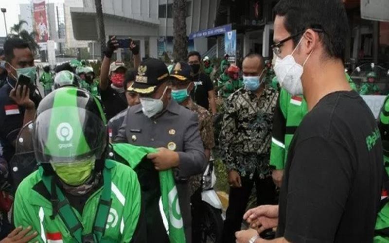 Ilustrasi - Pengemudi Gojek saay mengikuti inisiatif J3K di Bekasi. - Antara