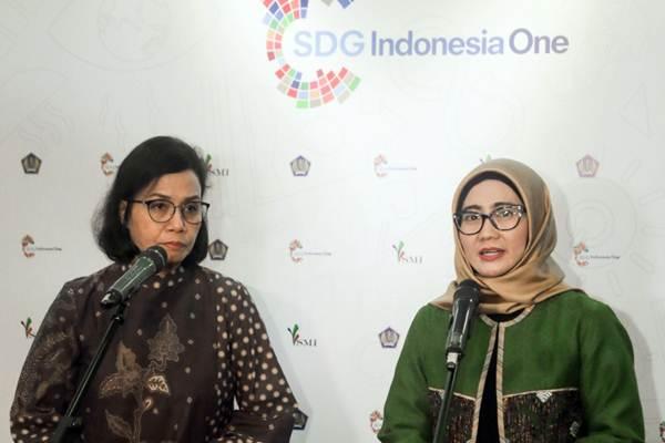 Menteri Keuangan Sri Mulyani (kiri) dan Emma Sri Martini ketika menjabat sebagai Presiden Direktur PT Sarana Multi Infrastruktur memberi keterangan di sela-sela peluncuran SDG Indonesia One di Jakarta, Jumat (5/10/2018). - JIBI/Felix Jody Kinarwan