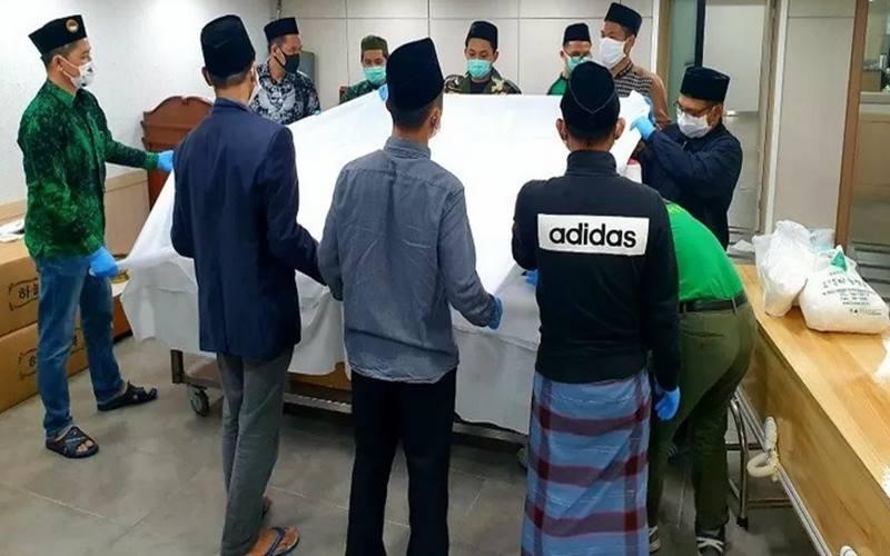 Pemulasaran jenazah pekerja migran Indonesia yang meninggal di luar negeri. - Antara