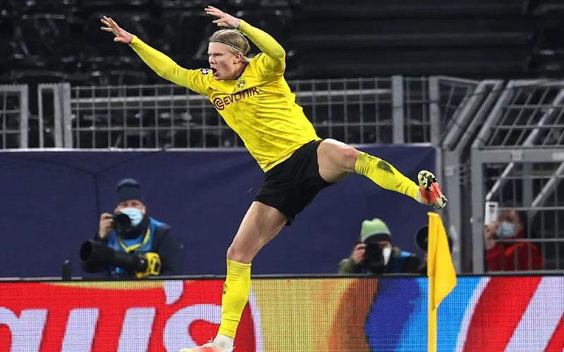 Penyerang Dortmund Erling Haaland setelah menjebool gawang Sevilla. - Bundesliga.com
