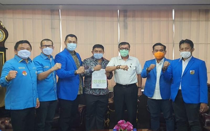 Menkumham Yasona Laoly dan jajaran tiga kubu pengurus KNPI