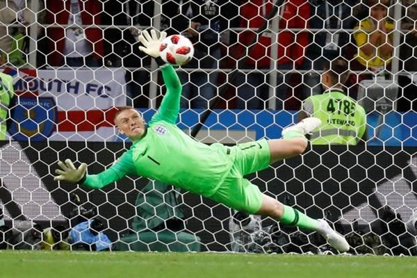Jordan Pickford ketika membela Inggris di Piala Dunia 2018 di Rusia. - Reuters