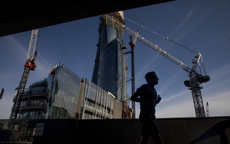 Ilustrasi kegiatan konstruksi properti. - Bloomberg