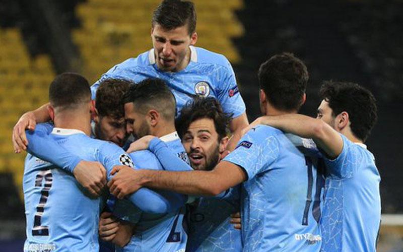 Para pemain Manchester City merayakan gol ke gawang Borussia Dortmund. - Twitter@ManCity