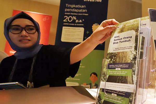 Karyawati melakukan aktivitas di salah satu perusahaan financial technology (Fintech), di Jakarta, Selasa (3/4/2018). - JIBI/Endang Muchtar