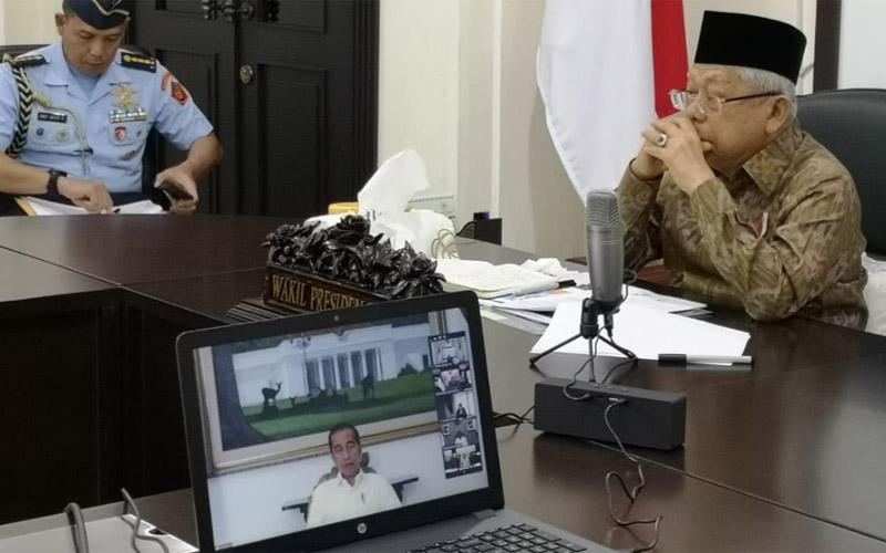 Wakil Presiden Ma'ruf Amin mengikuti Rapat Terbatas Kabinet dengan Presiden Jokowi melalui video conference, Senin 916/3/2020). - Bisnis/Nindya Aldila