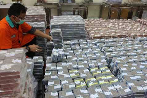 Ilustrasi tumpukan uang.