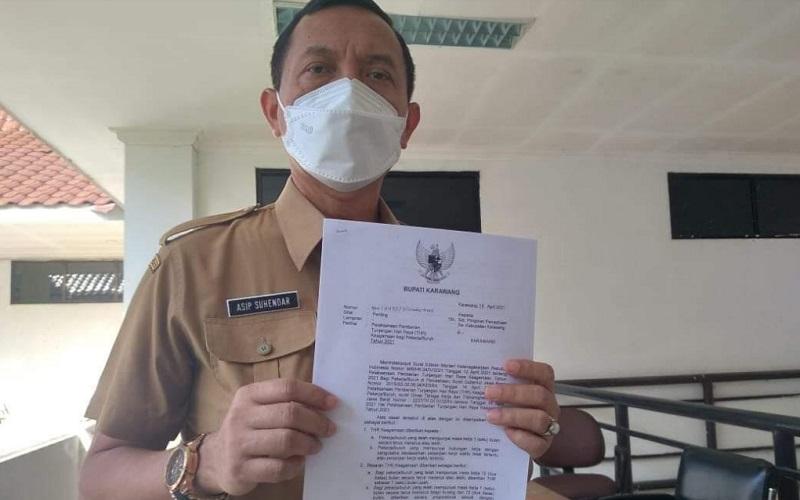 Kepala Dinas Tenaga Kerja dan Transmigrasi Karawang Asip Suhendar. - Istimewa
