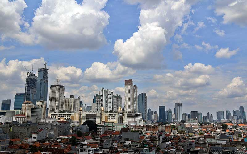 Suasana gedung bertingkat dan perumahan padat penduduk di Jakarta./Bisnis - Eusebio Chrysnamurti