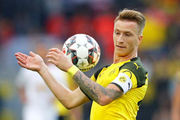 Ujung tombak dan kapten Borussia Dortmund Marco Reus - Reuters