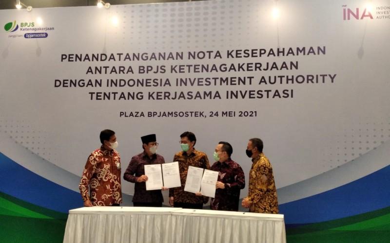 Penandatangan Nota Kesepahaman BPJS Ketenagakerjaan dengan INA - Bisnis/Aziz Rahardian